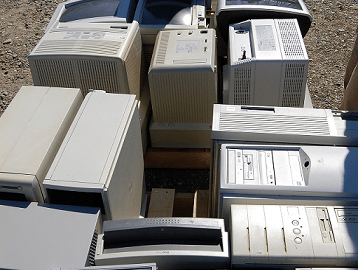 old electronics lined up on the ground ready to be recycled