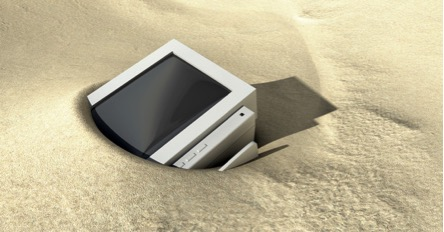 computer monitor stuck in a sand dune