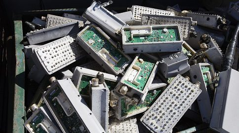 old electronics in recycling bin