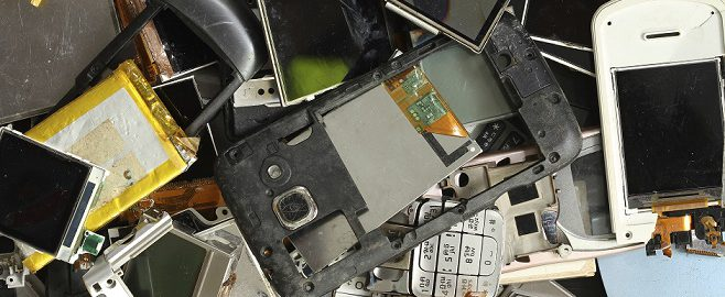 close up of old and broken cell phones