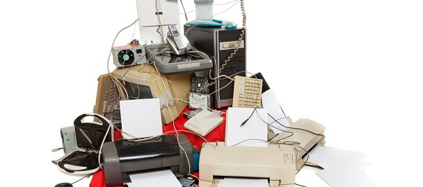 old electronics in a pile on the floor